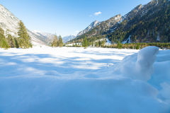 Snow fall early winter and late autumn. Alps landscape with snow capped mountains in the late autumn season. Royalty Free Stock Photography