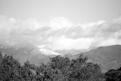 Snow fall on the hills b/w. Snow fall on local hills is Southern California, after the rain, rare occurance to see snow in Orange County Royalty Free Stock Images