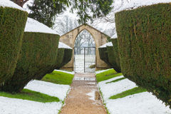 Snow fall on Yew hedges in formal, historic garden at Rousham House, Oxfordshire, England Stock Images