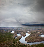 Snow falling above forest river Stock Photography