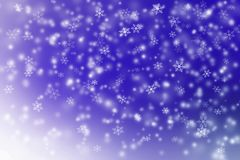 Snow falling on blue and white background Stock Photography