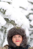 Snow falling on the cap. Woman with Snow falling on her fur Cap Stock Image