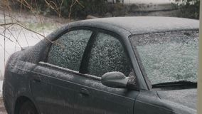 Snow falling on car. Light snow falling on car stock video footage