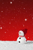 Snow falling on a Christmas decoration snowman Royalty Free Stock Image