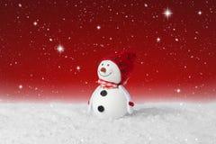 Snow falling on a Christmas decoration snowman Stock Photos