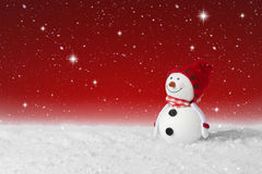 Snow falling on a Christmas decoration snowman Stock Photography