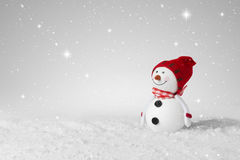 Snow falling on a Christmas decoration snowman Stock Images