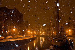 Snow falling in the city Groningen. At night Stock Photo
