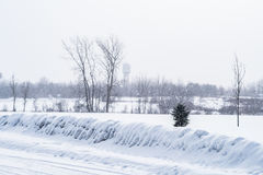 Snow falling in countryside. Snow falling in small rural town in Canada Royalty Free Stock Photography