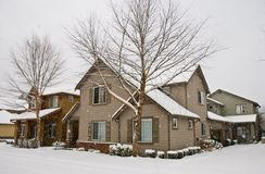 Snow falling, covering residential homes and stree Royalty Free Stock Images