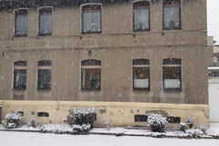 Snow falling in front of an urban townhouse Royalty Free Stock Photo