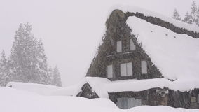 Snow falling on the house,in Toyama,Japan stock video footage