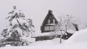Snow falling on the house,in Toyama,Japan stock footage