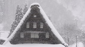 Snow falling on the house,in Toyama,Japan stock video