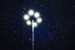 Snow falling in the light of a lantern. Snow falling in the light of a lantern Stock Image