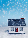 Snow Falling on Model House Royalty Free Stock Photos