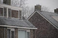 Snow falling in Netherlands. At roofs of houses in Nieuwerkerk aan den IJssel Royalty Free Stock Photos