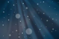 Snow falling from the night sky Royalty Free Stock Image