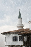 Snow falling on old castle Stock Photography
