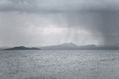 Snow falling over Arthur's Seat and Inchkeith Royalty Free Stock Photos