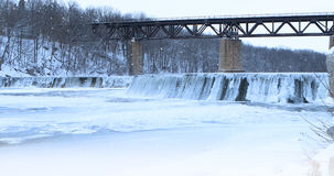 Snow falling on a river scene Royalty Free Stock Photography