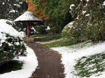 Snow falling on sidewalk  in Japanese garden Royalty Free Stock Images