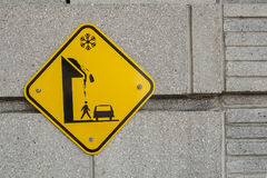 Snow falling sign. Snow falling street danger sign on a wall of a building Royalty Free Stock Photos