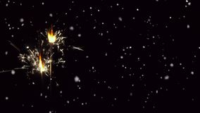 Snow falling and sparkler animated on  black background stock footage