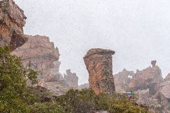 Snow is falling at the Stadsaal Caves in Cederberg Mountains. STADSAAL CAVES, SOUTH AFRICA, AUGUST 26, 2018: Snow is falling at the Stadsaal Caves in the stock images