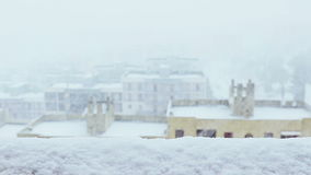 Snow. Falling from window snowflakes with dolly camera movement with city view stock video