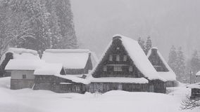 Snow falling on the winter house,in Toyama,Japan stock video