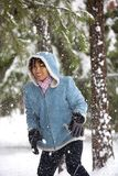 Snow falling on a woman. Stock Photo