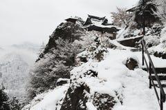 Snow falling at yamadera shrine in japan winter Stock Photos