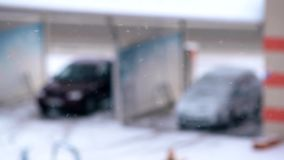 Snow falls on blurred background with cars stock video