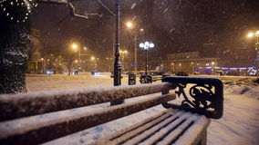 Snow falls in a christmass city stock video footage