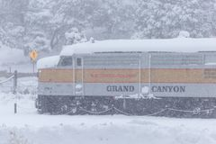 Snow falls at the Grand Canyon Railway train station. royalty free stock image