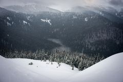 The snow falls in the mountains Royalty Free Stock Image