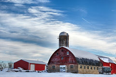 Snow Farm. During a long cold winter a farm sits under over a foot of snow and ice Royalty Free Stock Photography