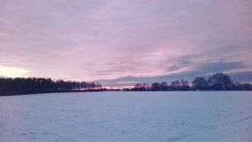 Snow at feeld sun. Snow feld winter Sonnenuntergang Royalty Free Stock Photography