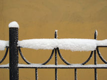 Snow fence. Part of decorative lattice covered with snow Royalty Free Stock Image