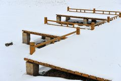 Snow on a fence. Snow on a wooden fencing Royalty Free Stock Photos