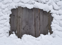 Snow on a fence Stock Photo