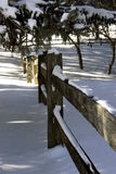 Snow fence. Winter scene of snow on spilt rail fence Royalty Free Stock Images