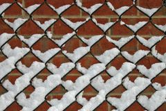 Snow in Fence Stock Photography