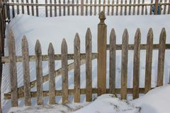 Snow and picket fence Stock Photos