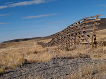 Snow Fence in Wyoming. Weather worn snow fence on the prairie in Wyoming Royalty Free Stock Image