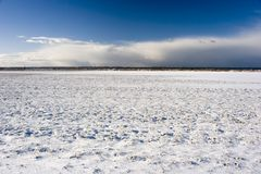 Snow Field. View of a snow field with stormy sky, in Sweden Royalty Free Stock Photo