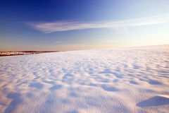 Snow in the field. The field covered with snow. A winter season Stock Image