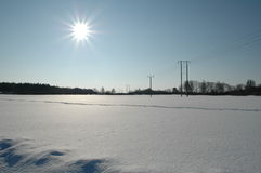 Snow field. With the sun in the background Stock Photo