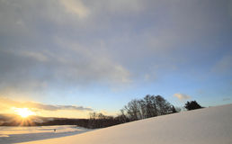 Snow field and blue sky Royalty Free Stock Photos